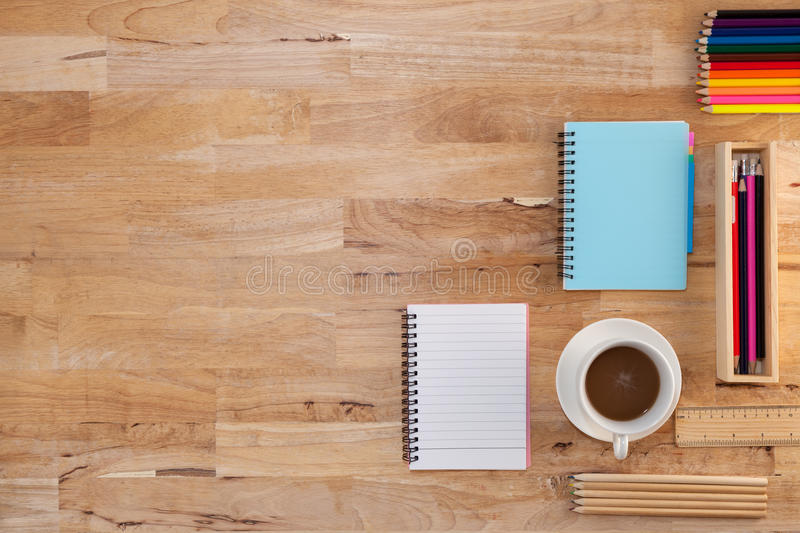 White coffee cup with paper note,pencil,ruler on wooden table ba royalty free stock image