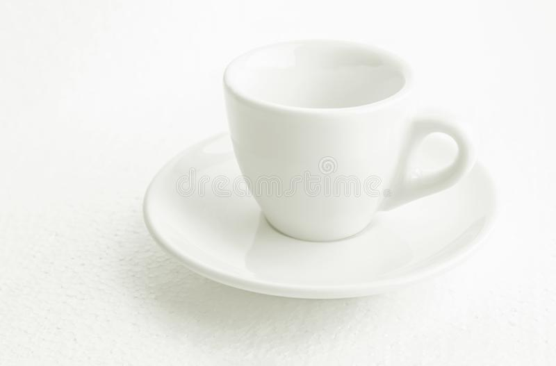 White coffee cup and saucer, empty coffee-free coffee cup, front view from above, or black coffee, on a white background royalty free stock image