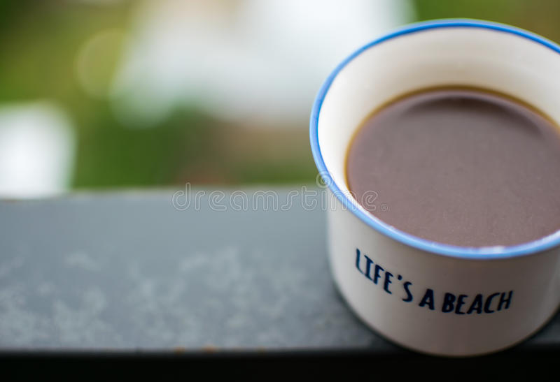 White coffee cup on steel beam royalty free stock photography