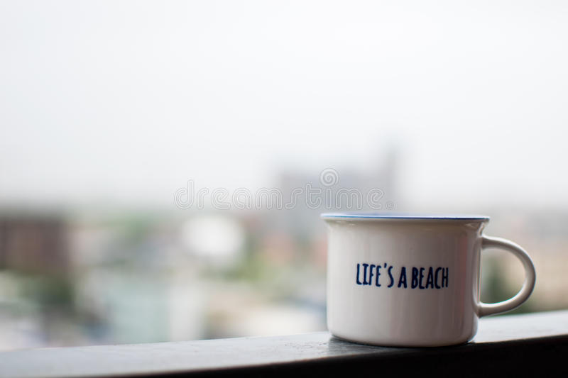 White coffee cup on steel beam stock photography