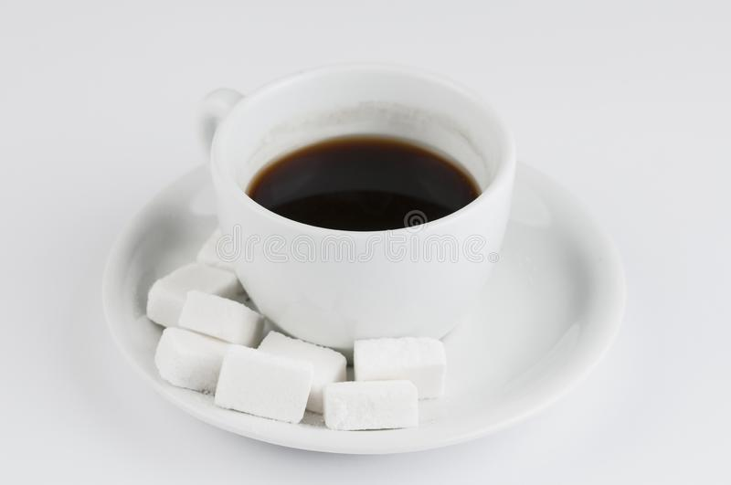 White coffee cup with sugar cubes isolated on white background. Drink closeup foam cafeteria brown aromatic morning tasty mug hot latte caffeine beverage dark royalty free stock images