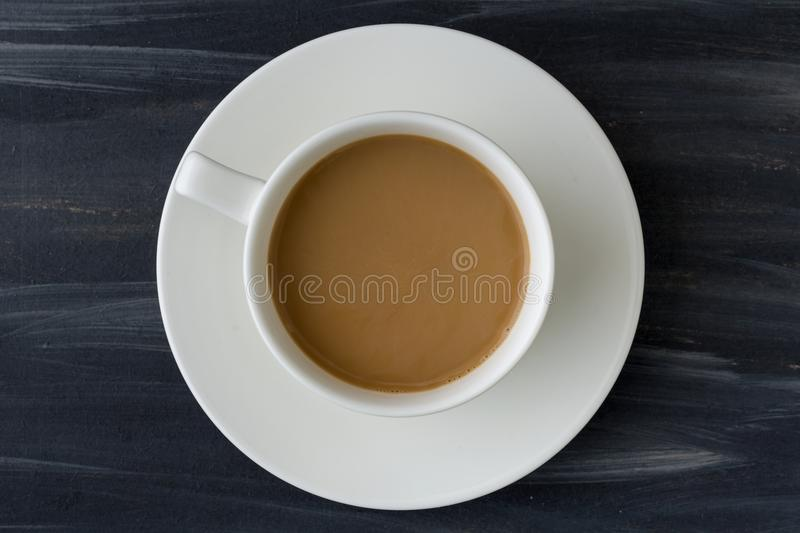 White coffee cup top view on black table background royalty free stock photos
