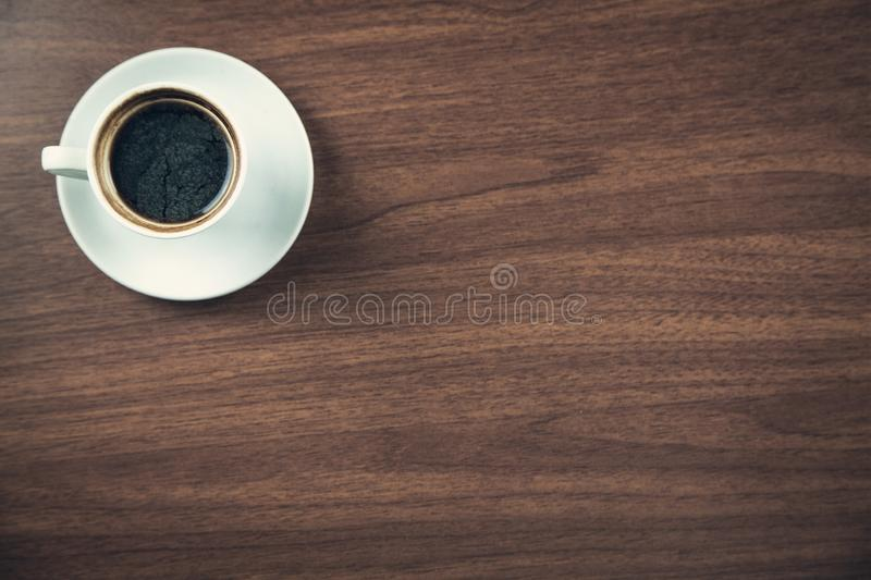 White coffee cup on a wooden desk stock image