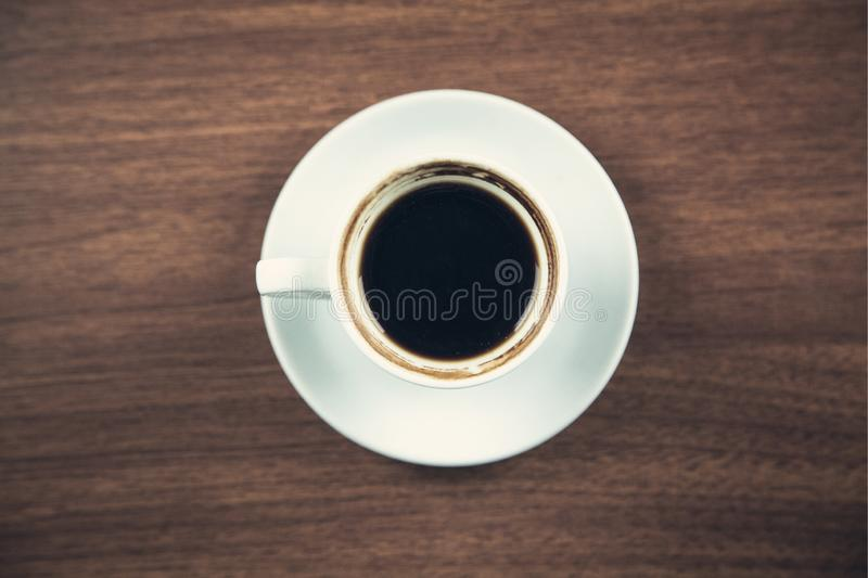 White coffee cup on a wooden desk royalty free stock photography