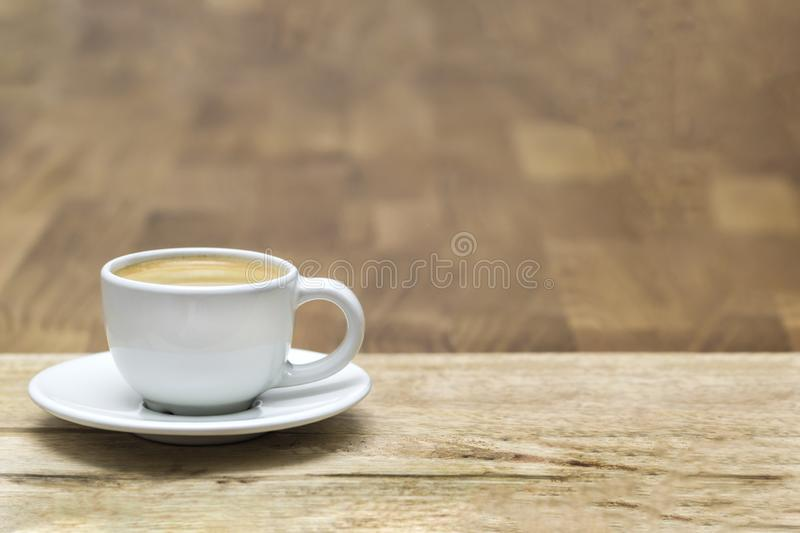 White coffee cup on oak wooden table. Copy space stock image