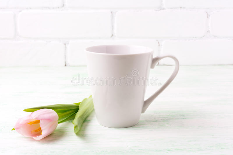 White coffee latte mug mockup with pink tulip stock image