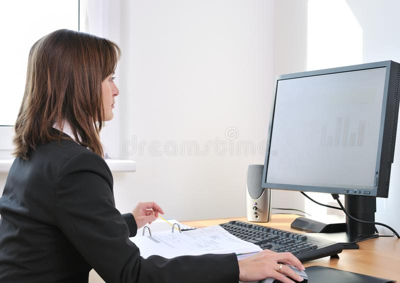 White collar worker at computer stock images