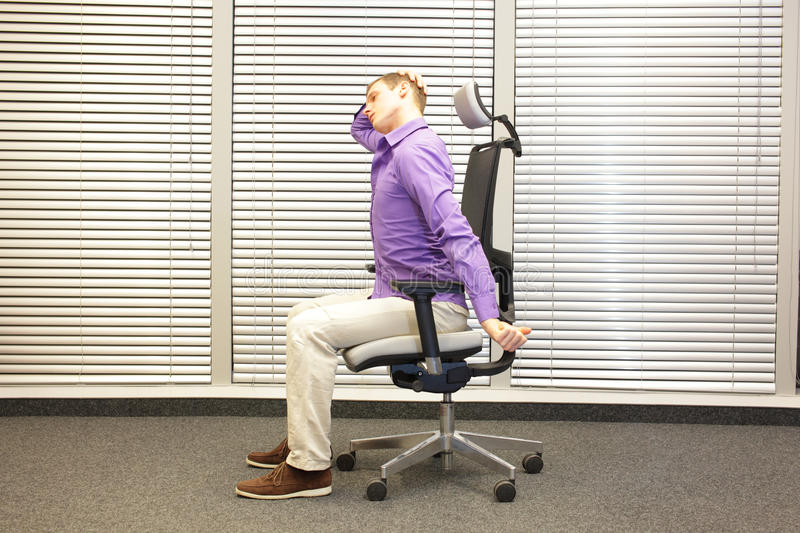 White collar worker male relaxing neck - demonstration. White collar worker male relaxing neck - short break for exercise in office royalty free stock images