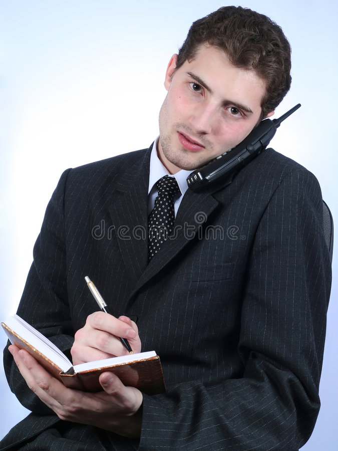 White-collar worker phone and writing stock photography