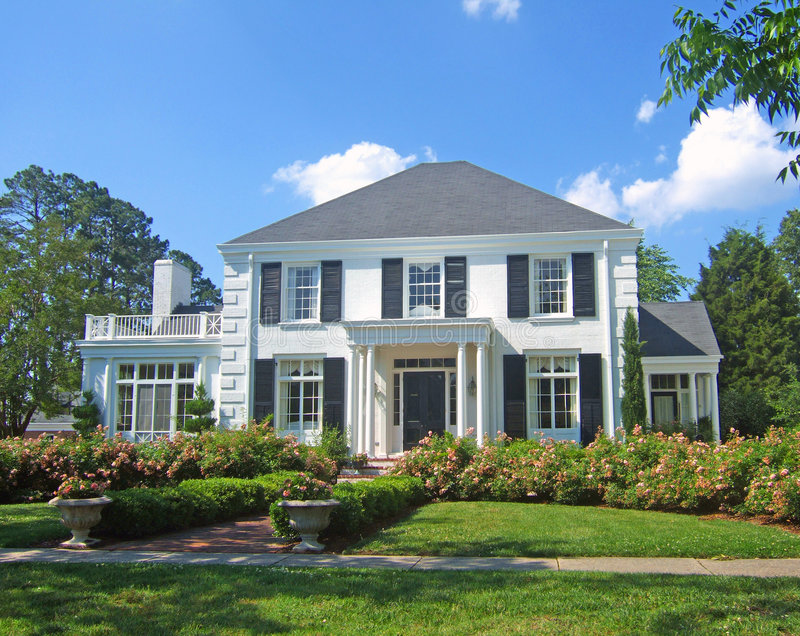 White colonial home stock photography