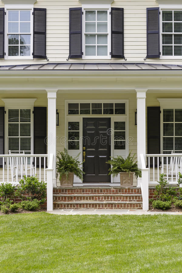Download White Colonial House Porch And Plants Stock Photo