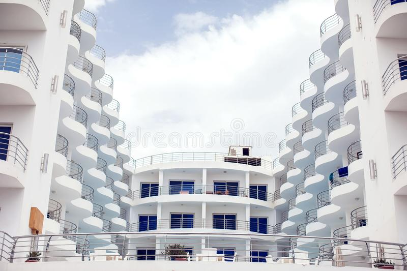 White color building with balcony. Architecture and design concept. White color modern building with balcony. Architecture and design concept royalty free stock images