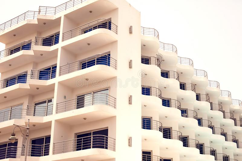 White color building with balcony. Architecture and design concept. White color building with balconies. Architecture and design concept royalty free stock photos