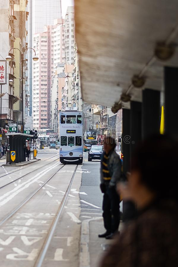 White color Double decker tram on a busy street in Sheung Wan district of Hong Kong Island, symbol of HK; Hong Kong, China, 16 stock images