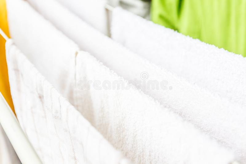 White and colored linen and towels to be dried on the clothesline royalty free stock photos