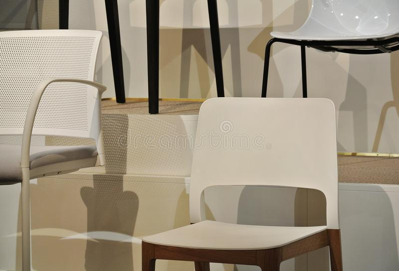 white and colored plastic chairs royalty free stock photography