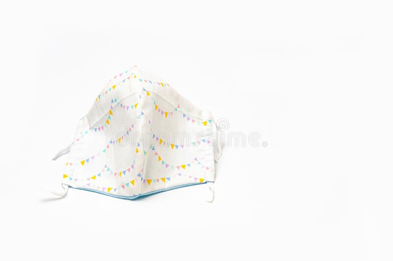 White with colorful triangular flags patterned DIY fabric face mask for protection against coronavirus COVID-19. And other infectious diseases. Isolated on royalty free stock images