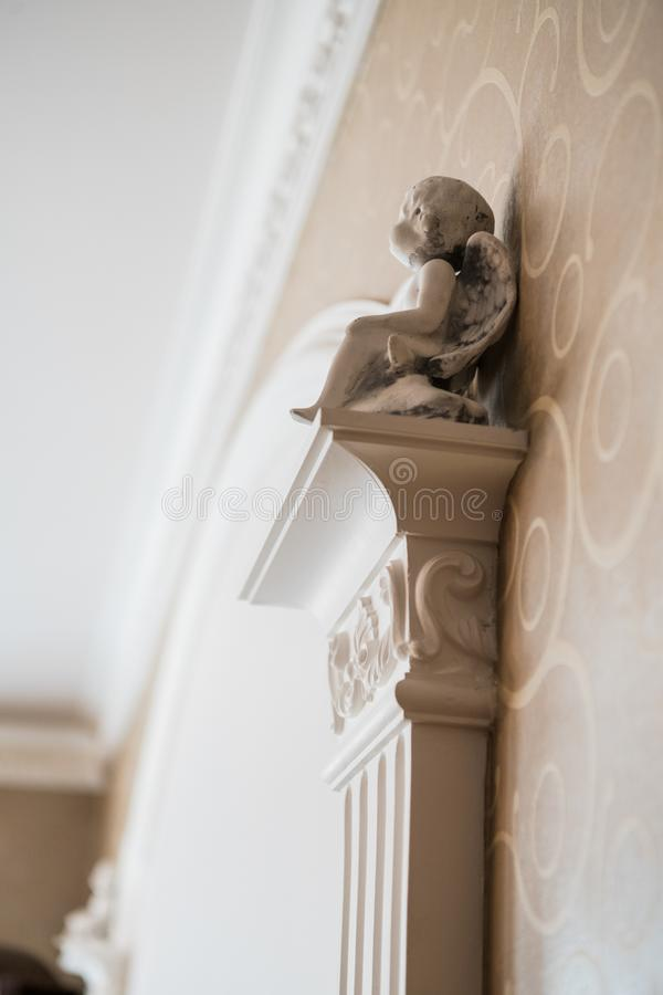 White column with portico decorative elements, classic interior fragment stock photography