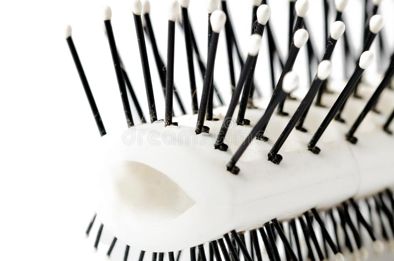 White comb with black handle isolated on white background, copy space. Hair, beauty, hairbrush, equipment, haircut, care, hairdresser, barber, fashion, symbol royalty free stock photography