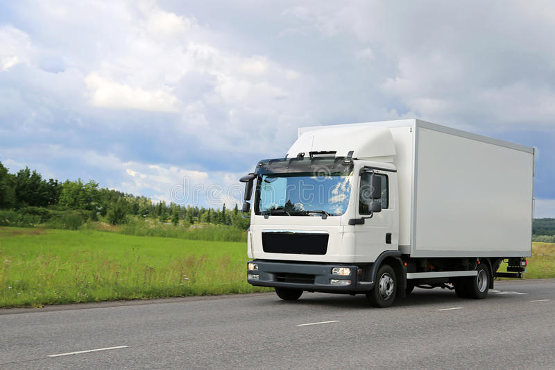 Download White Commercial Delivery Truck On The Road Stock Photo - Image of lorry, regional: 56927360