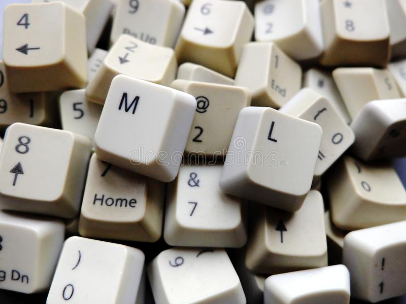 White computer keyboard keys, mostly numeric with ML Machine learning buttons at the front. Concept of unstructured big data. That need to be sorted ready to be royalty free stock photos