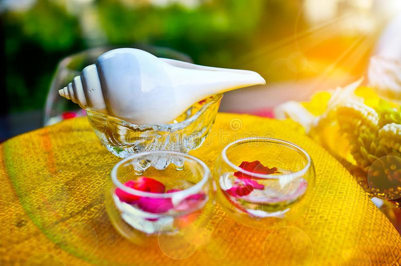 White conch shell and water bowl set for water Blessing in wedding day. stock photography