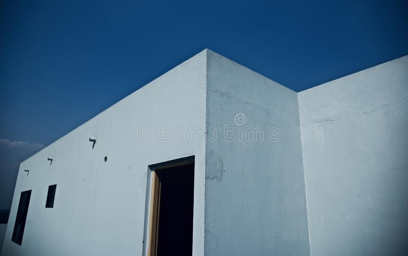 White concrete building with a opened door royalty free stock images
