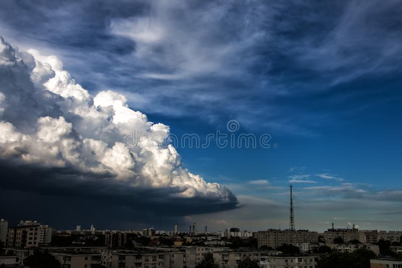 White Concrete High Rise Building Under Gray White Clouds during Daytime royalty free stock photography