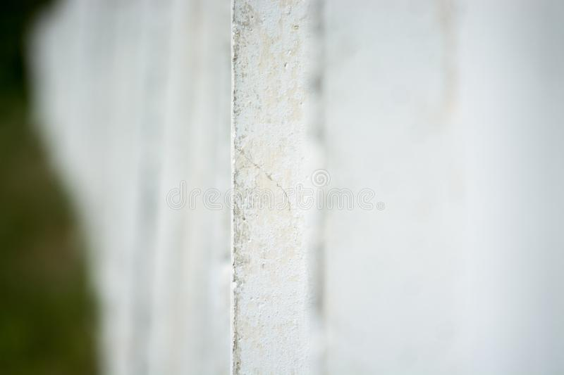 White concrete wall of the Soviet era. The junction between the plates. Fragment of the wall. Beauty stock image