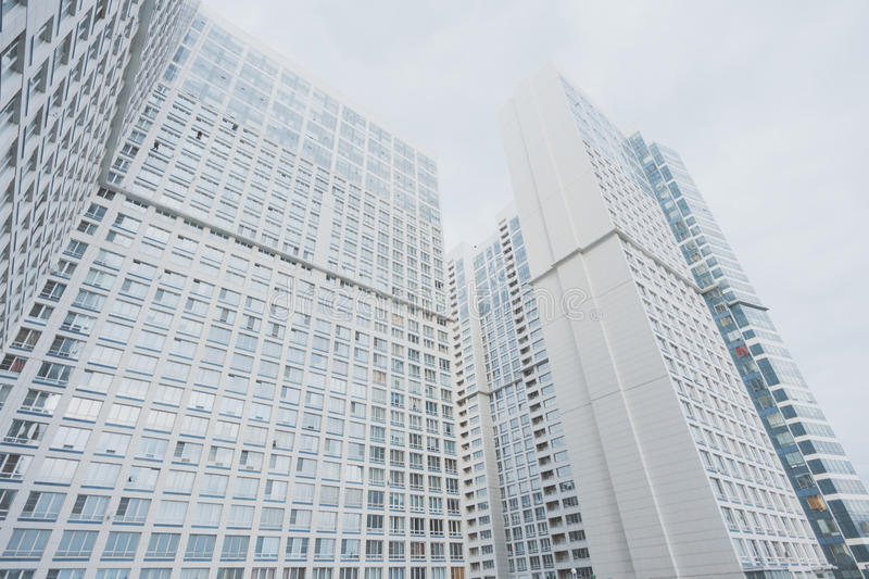 White contemporary residential skyscraper apartment building. In Moscow on a cloudy day with regular windows, view from bottom stock photo