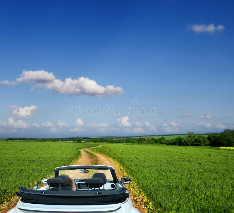 Download White Convertible On A Country Road Through Fields Royalty Free Stock Images - Image: 34128789