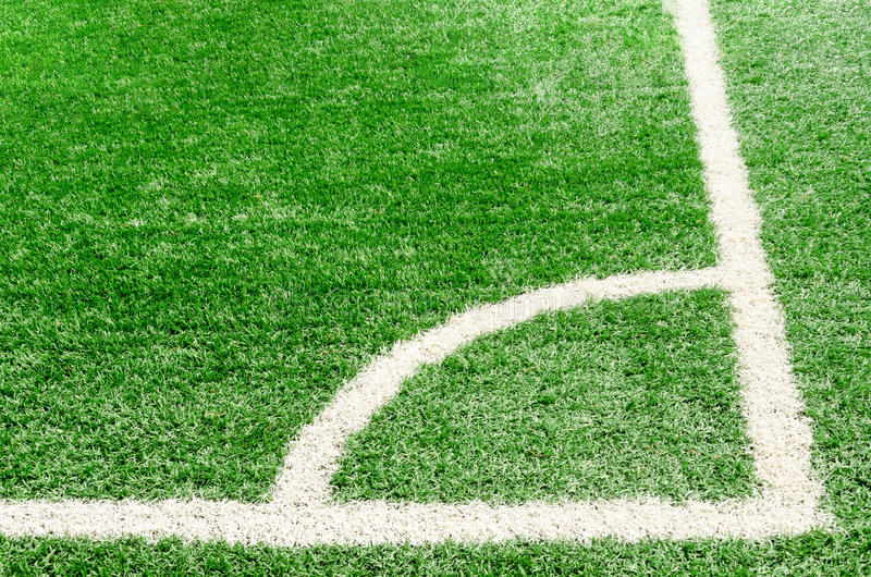 White corner field line on artificial green grass of soccer field stock photo