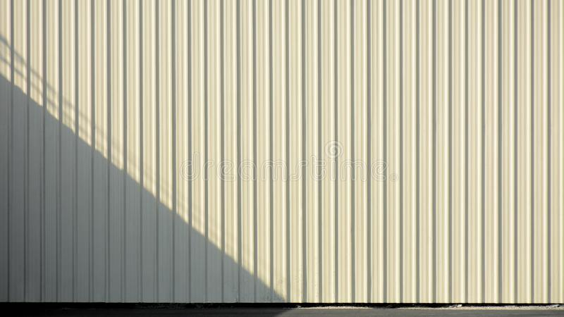 White corrugated metal wall with shadow. ​ background stock photo