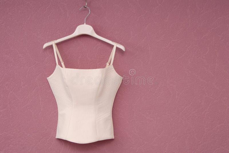 White corset, wedding corset, white bodice is on the lilack back stock photos