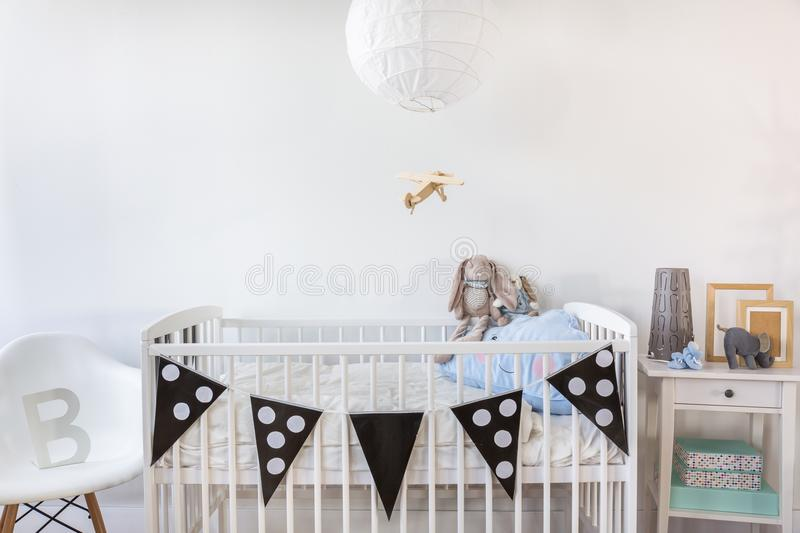 White cot with decoration. Image of white baby cot with decoration stock images