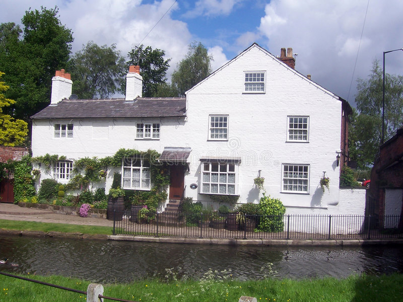 White cottage stock photography