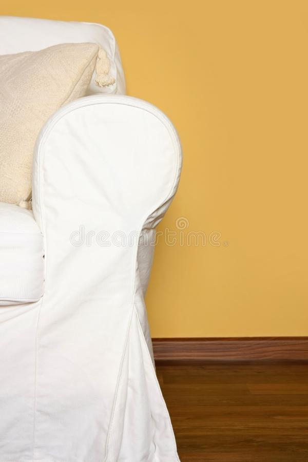 White couch near yellow wall royalty free stock photography