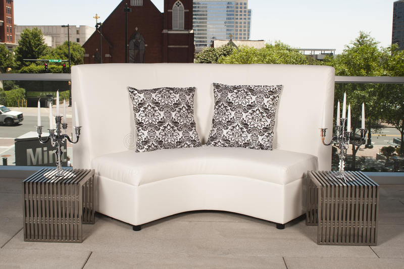 White Couch Outside. White couch with black and white pillows set up outdoors royalty free stock photography