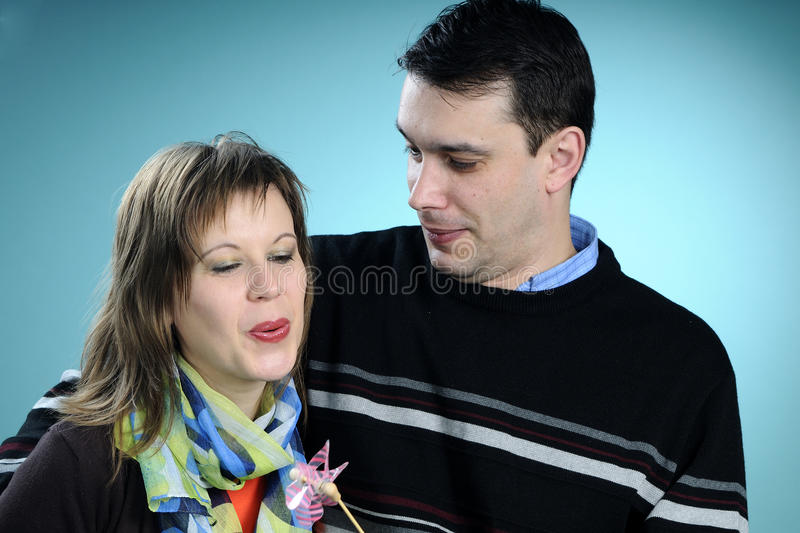 White couple blowing and playing royalty free stock photos