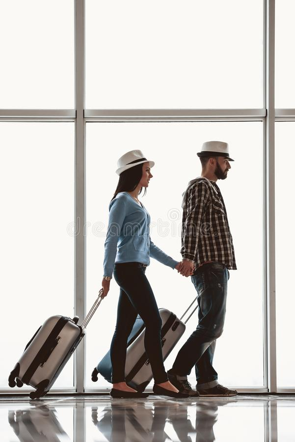 White couple holding hand with suitcase at airport royalty free stock photo