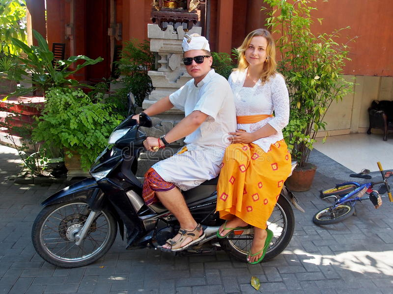 White Couple On The Motorbike In Balinese Style royalty free stock photos