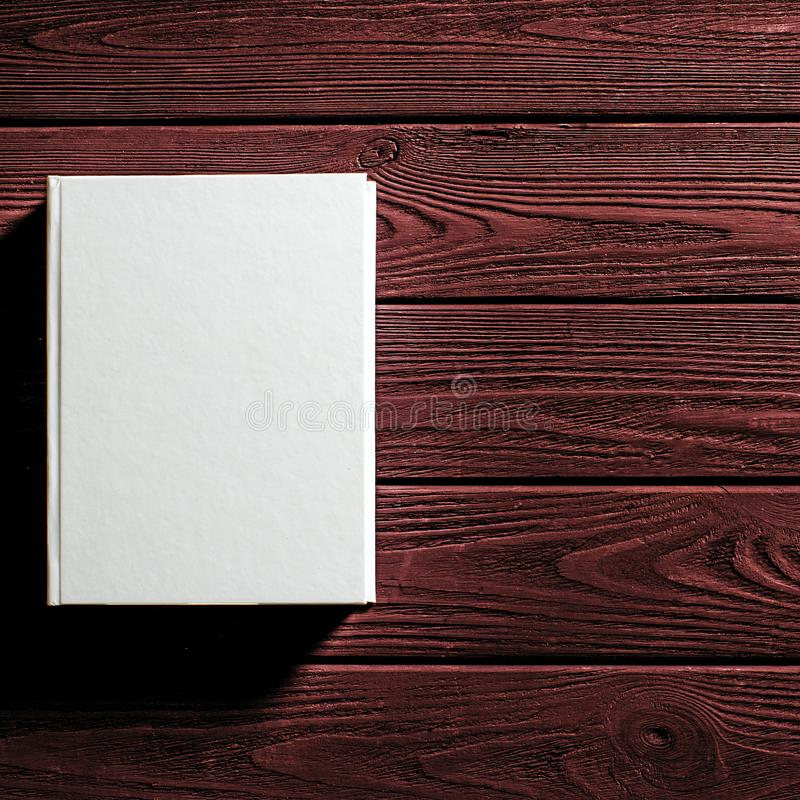 The white-cover book is on a textured wooden table. Copy spase, education, library, background, paper, empty, design, old, open, page, classic, retro, vintage stock photos
