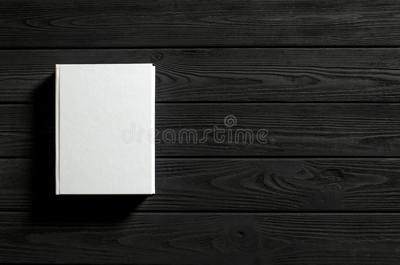 The white-cover book is on a textured wooden table. Copy spase, education, library, background, paper, empty, design, old, open, page, classic, retro, vintage royalty free stock photos