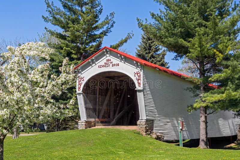 White Covered Bridge with Red Roof royalty free stock photography