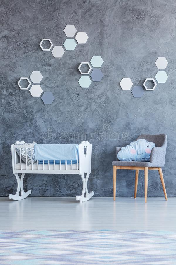 White cradle in kid`s room stock photography