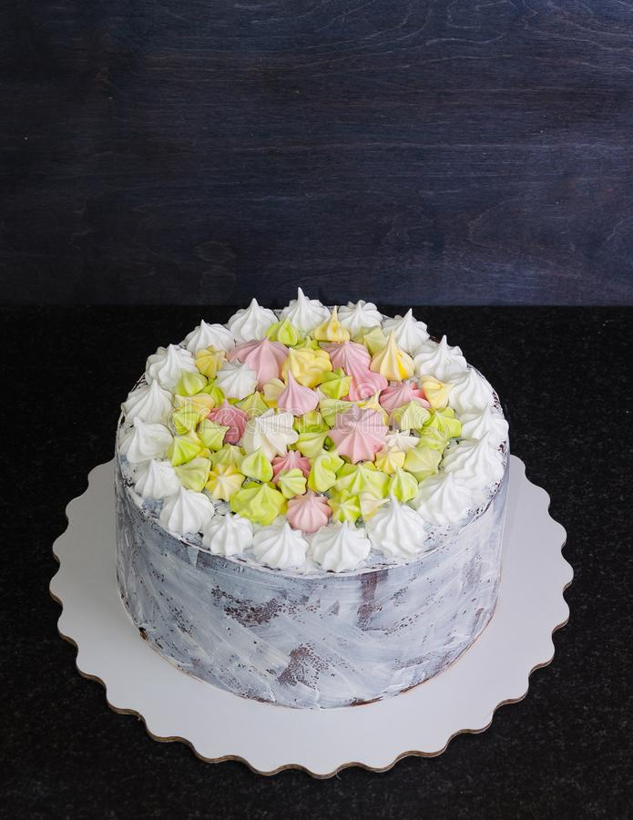 White craquelure cake with gentle merengues. A white craquelure cake with gentle merengues royalty free stock photo