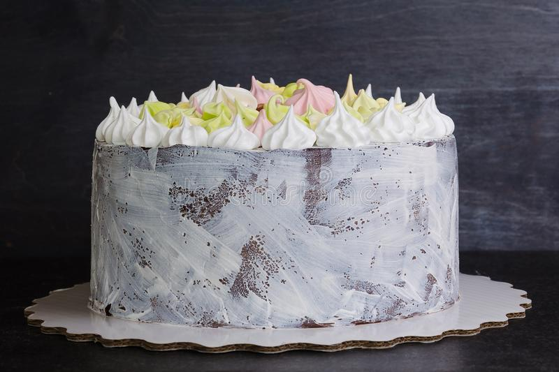 White craquelure cake with gentle merengues. A white craquelure cake with gentle merengues stock photography