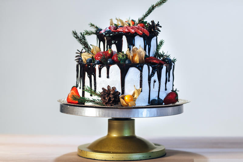 White Cream Icing Cake with Fruits and Chocolate, Wedding naked cake on white background, side view stock photography