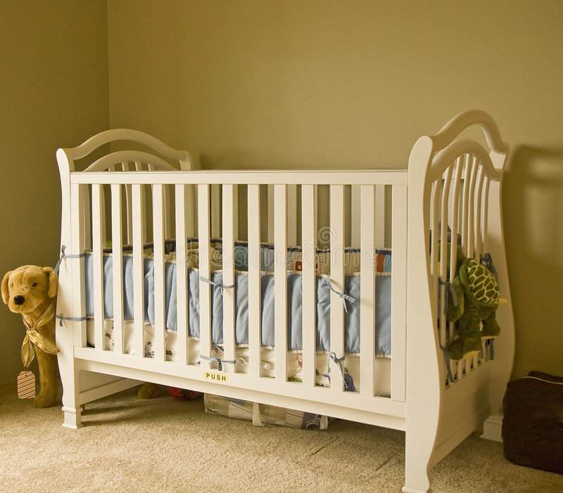 White Crib. A classic white crib in a baby's room stock photo