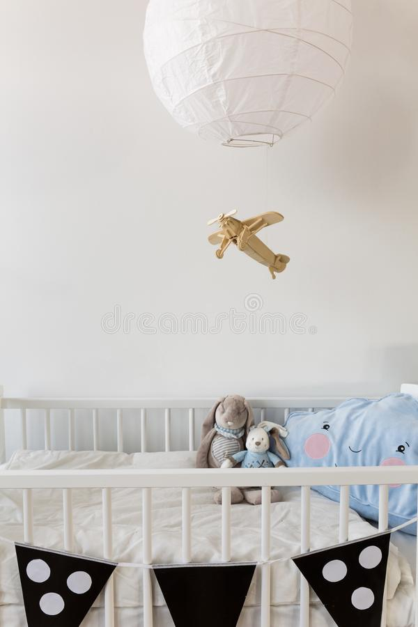 White crib for newborn baby. Mascots in white crib for newborn baby stock photography